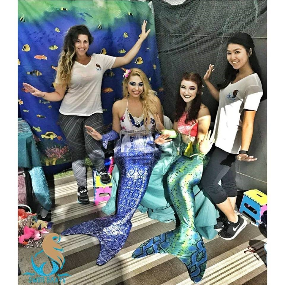 Candace Thome, founder of the Swim Brayv nonprofit, stands with her mermaid-costumed volunteers at an event to impart swim safety education to children.