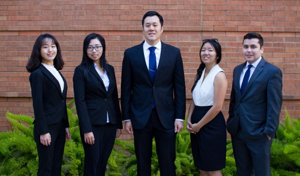 A group of accounting students pose outside Steven G. Mihaylo Hall at Cal State Fullerton.
