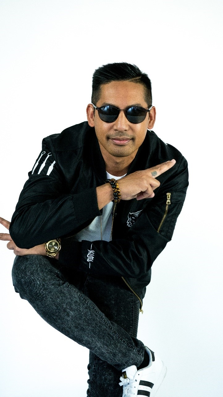 Hip hop dance enthusiast Arnel Calvario poses with black sunglasses and a black jacket.