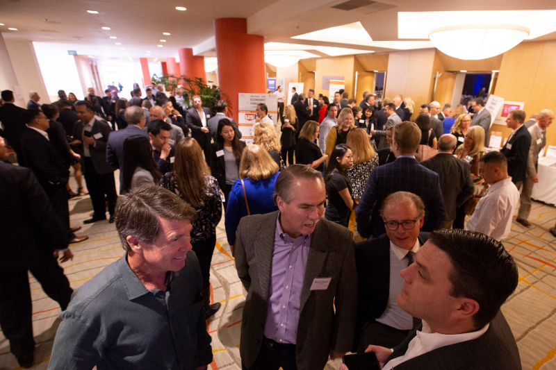 A crowd of business professionals in the lobby of the Hotel Irvine at the CSUF Mihaylo College Economic Forecast on Oct. 25, 2018.