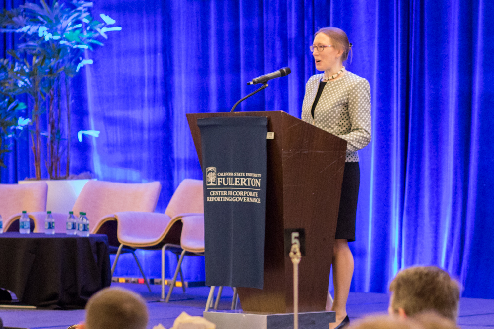 """SEC Commissioner Hester Peirce at the podium of the Hotel Irvine conference room at the CSUF Mihaylo SEC """"Hot Topics"""" Conference on Sept. 21, 2018."""