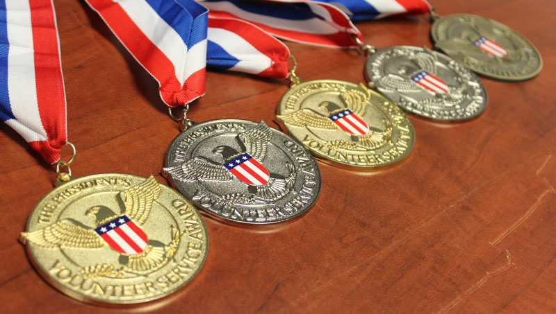 Five Volunteer Service Award medals bestowed by President Obama on the staff of the International Surf Lifesaving Association (ISLA).