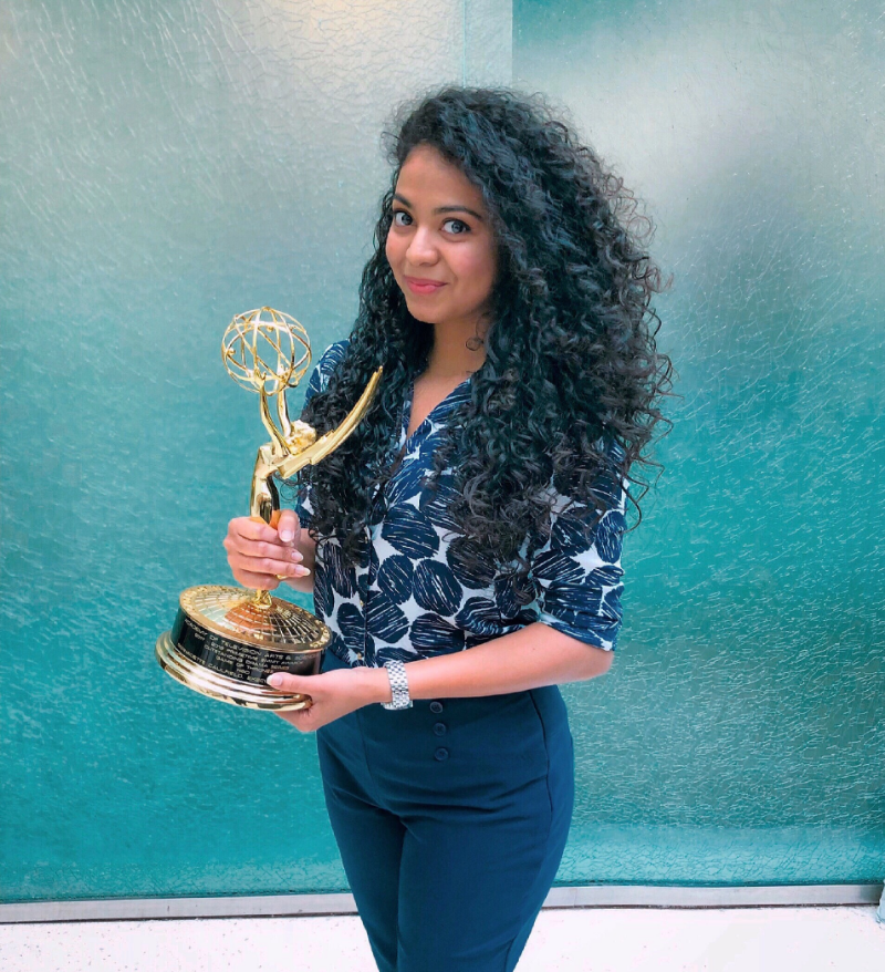 Tanvi Bobde, CSUF Mihaylo College alumna and HBO data analyst, holding the Emmy award for Outstanding Drama Series, which was bestowed upon Game of Thrones in 2018.
