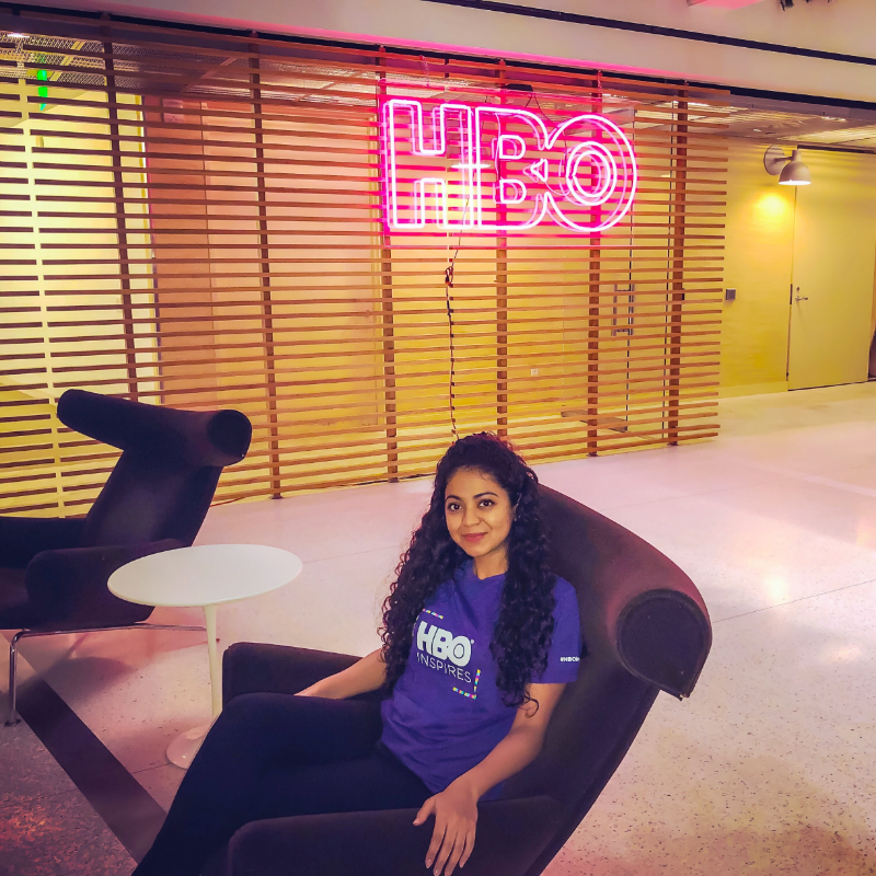 CSUF Mihaylo alumna and HBO Data Analyst Tanvi Bobde in the lobby of HBO's Los Angeles offices.