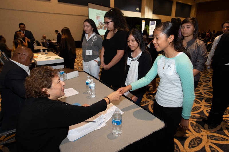 Students interact with judges at the 2018 Titan Fast Pitch competition at Cal State Fullerton in the Titan Student Union.