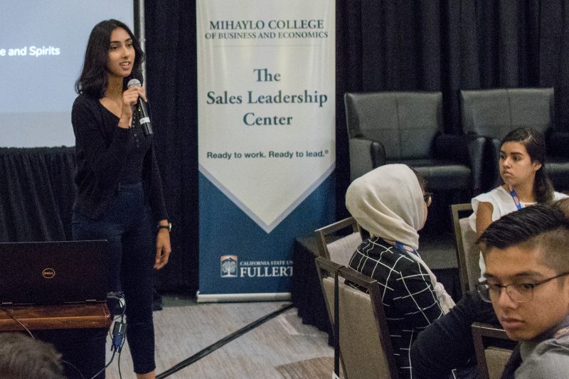 Kami Kaur, vice president of recruitment at the Sales Leadership Center at Cal State Fullerton's Mihaylo College, speaks at the Sales Career Academy on Sept. 28, 2018.
