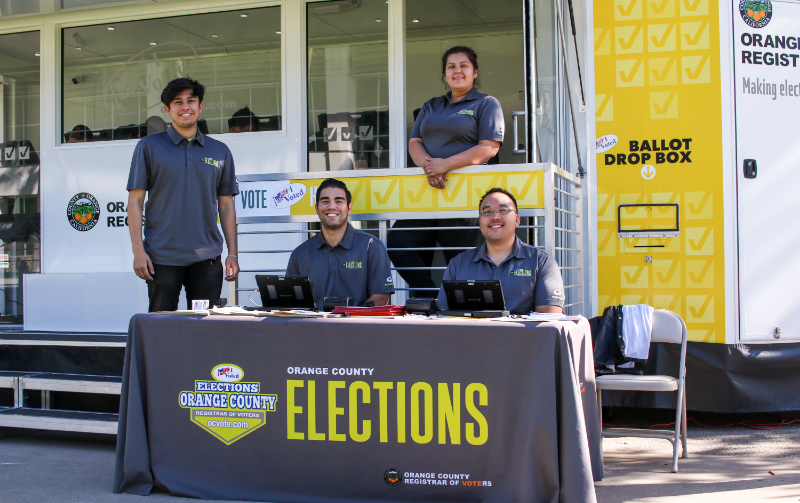Staff from the Orange County Registrar of Voters outside of the Early Pop-Up Voting booth at Tuffy Lawn at Cal State Fullerton on Thursday, Nov. 1, 2018.