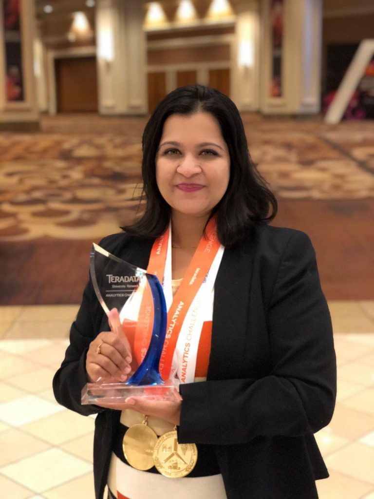 Mansi Bhat, Cal State Fullerton ISDS graduate student, holds the award she received for her research presentation at the 2018 Teradata Competition in Las Vegas.