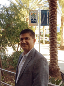 Tony Modiri, the Cal State Fullerton head of information security, in front of College Park and Nutwood Avenue.