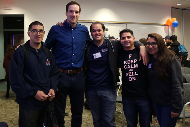 Olympic volleyball bronze medalist Murphy Troy poses with Cal State Fullerton Sales Leadership Center students during his visit to campus on Feb. 5, 2019.