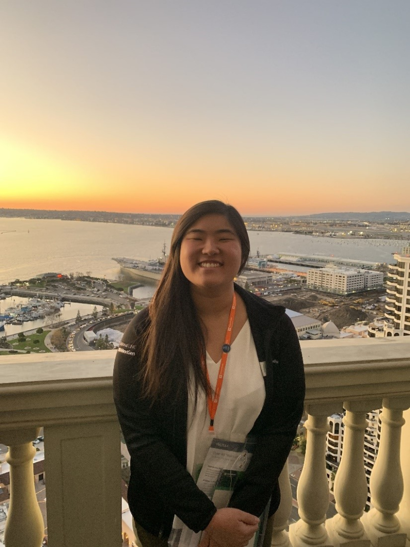 Cal State Fullerton personal financial planning student Rachel Shin, with the sunset on the San Diego Bay in the background.