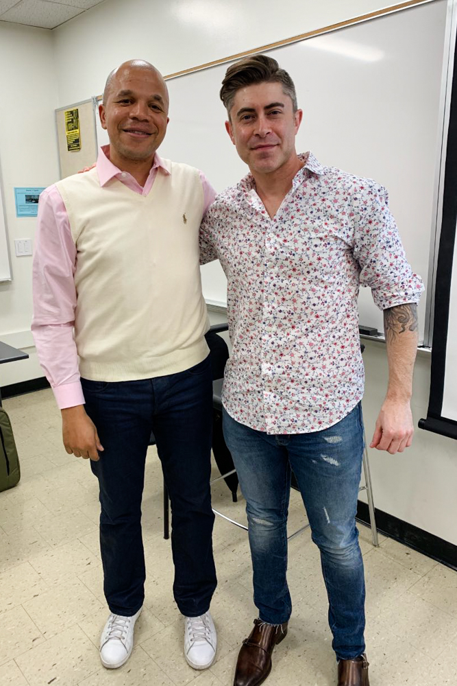 Cal State Fullerton Management Lecturer Amani Roberts poses next to Adam Gubman, composer, arranger and writer for Moonwalk Audio.