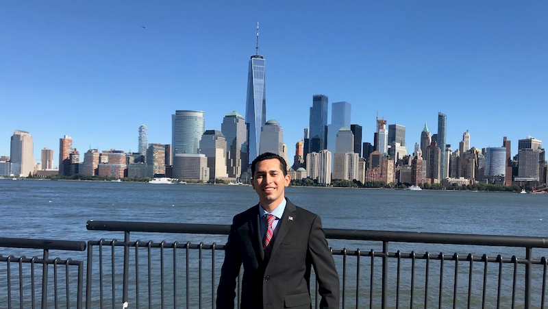 Isai Salmeron with the Lower Manhattan skyline in the background. The Cal State Fullerton student was in New York City to interview for an internship with Goldman Sachs.