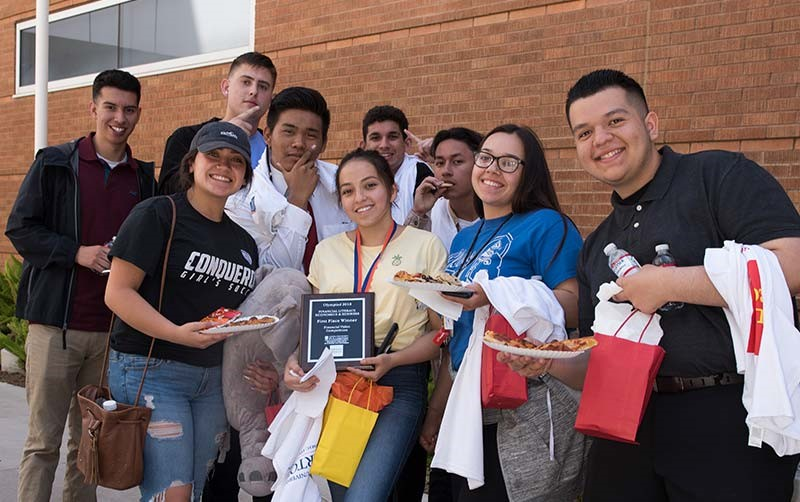 Students celebrate a victory at the Cal State Fullerton Center for Economic Education business olympiad.