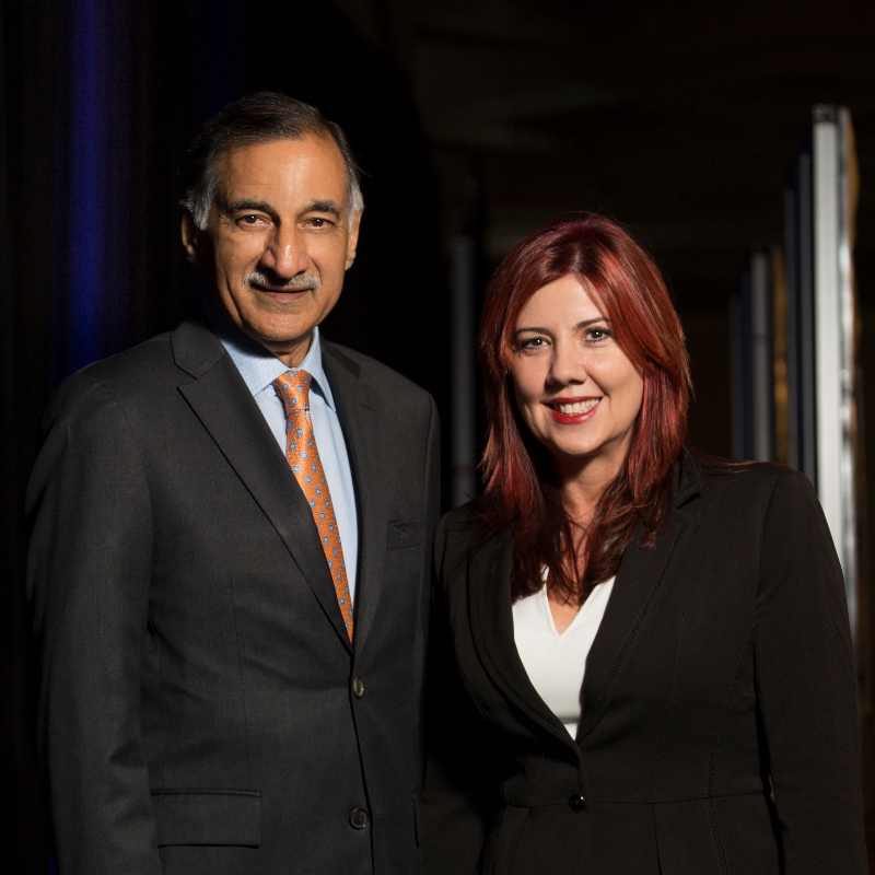 Anil Puri and Mira Farka pose at the Economic Forecast Conference in fall 2017.