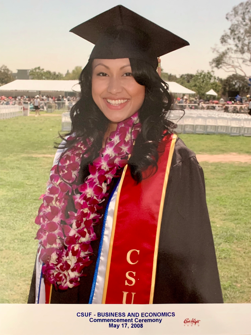 Sathya Chey in cap and gown on her graduation day at Cal State Fullerton in May 2008.