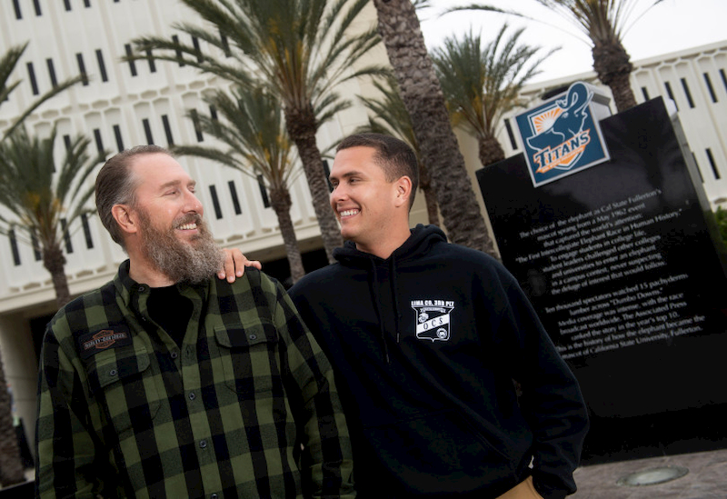 Cal State Fullerton management students Nick Deitz and his son Seth pose in front of Langsdorf Hall.