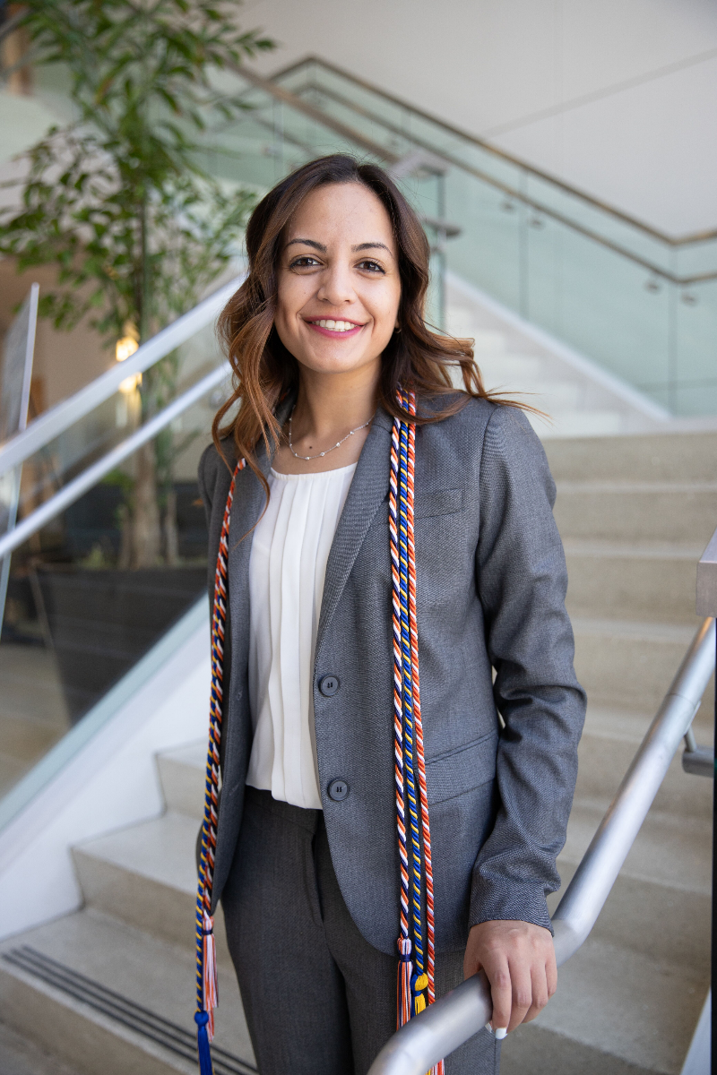 Former CSUF President Laila Dadabhoy, a 2019 Mihaylo College commencement speaker, poses in the lobby of Steven G. Mihaylo Hall.