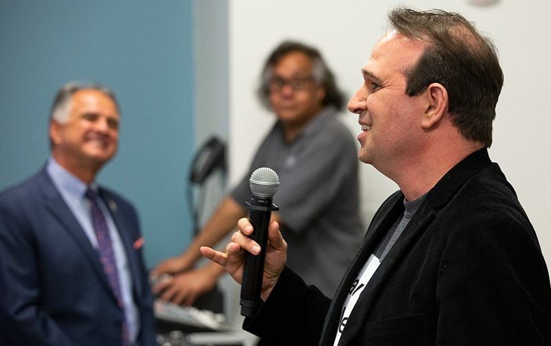 Cal State Fullerton ISDS Professor Ofir Turel holds the microphone when honored with the L. Donald Shields Excellence in Scholarship and Creativity Award, bestowed by the CSUF Academic Senate on May 2, 2019.