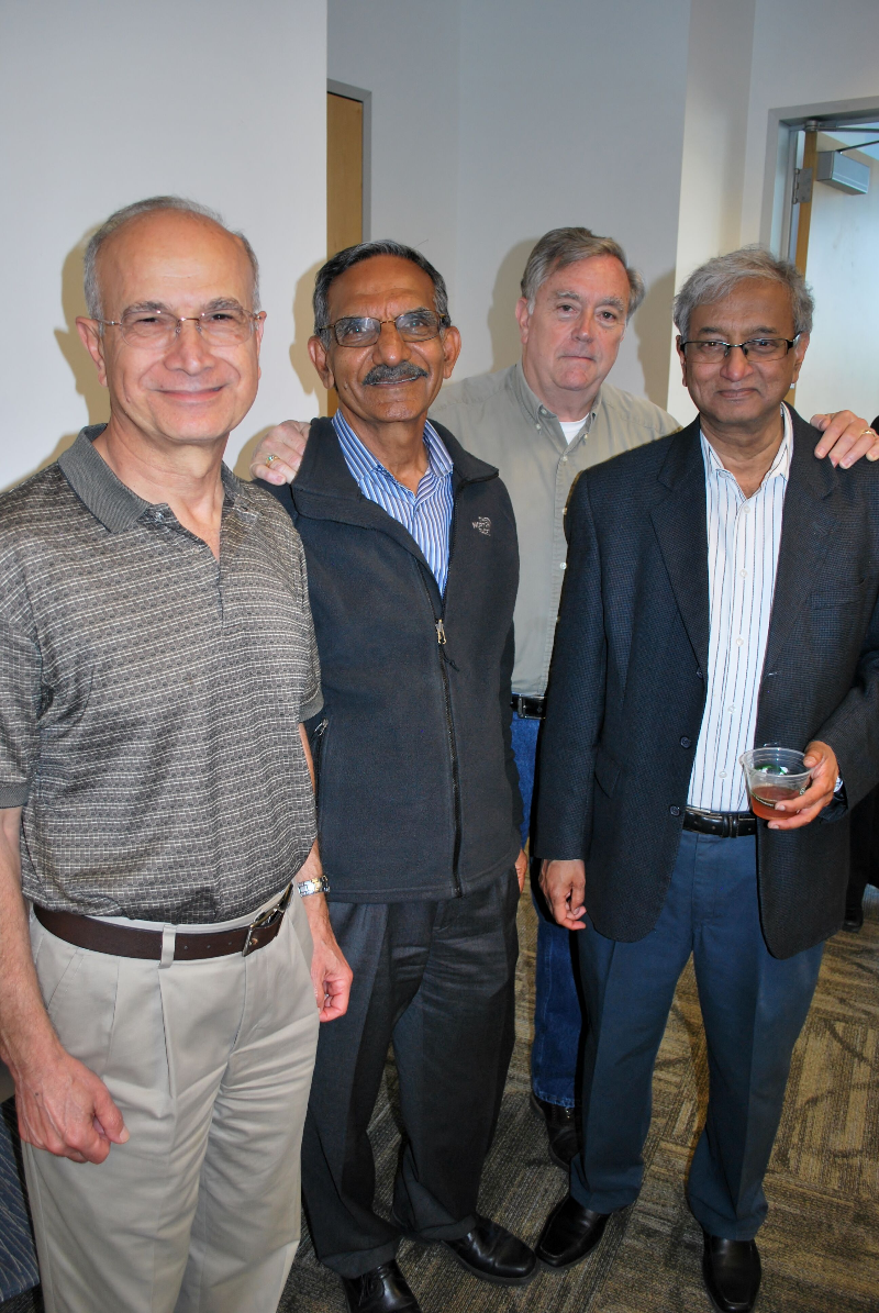 Bhushan Kapoor, Mihaylo College ISDS professor, poses with other faculty at Cal State Fullerton's business college.