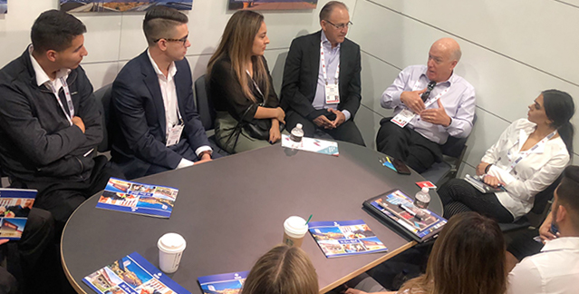 Real estate professionals, including Cal State Fullerton alumnus Pat Donahue, and Center for Real Estate director Bob Osbrink speak to Cal State Fullerton real estate students.