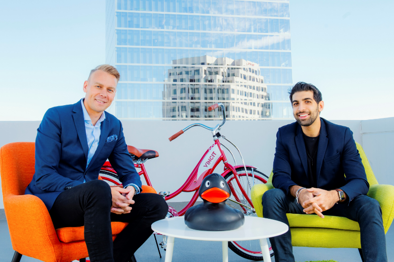 Dalip Jaggi, founder of Devise Interactive, sitting with Vincit's vice president, Hans Vallden.