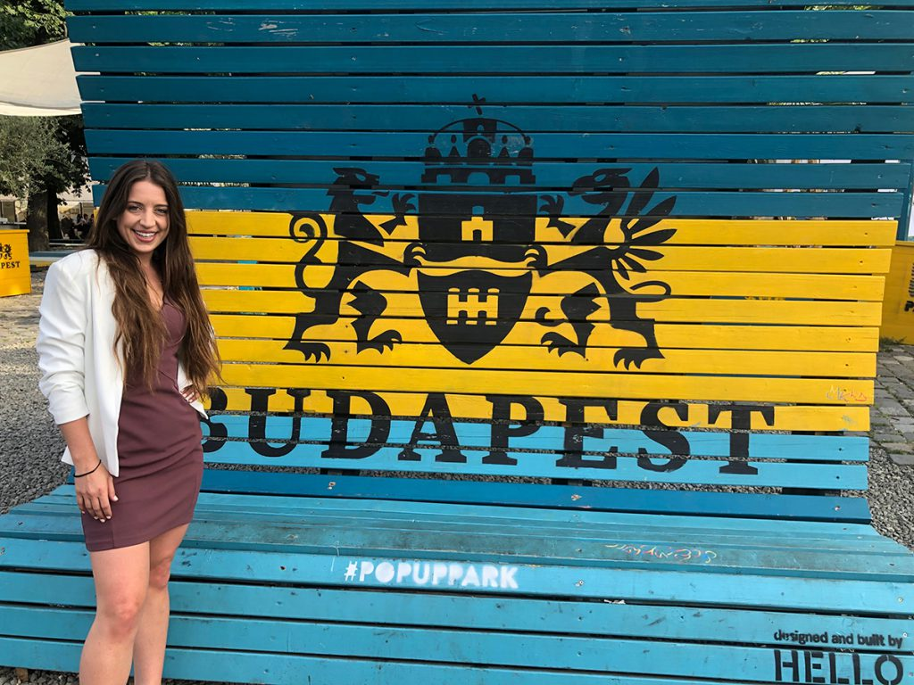 Mara Clifford, a Cal State Fullerton accounting student, poses in front of unique architecture in Budapest, Hungary.