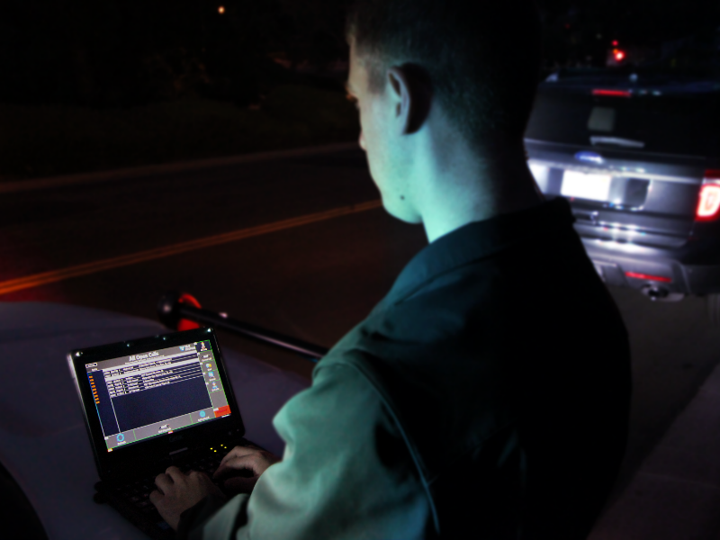 A police officer uses 10-8 Systems at a traffic stop.
