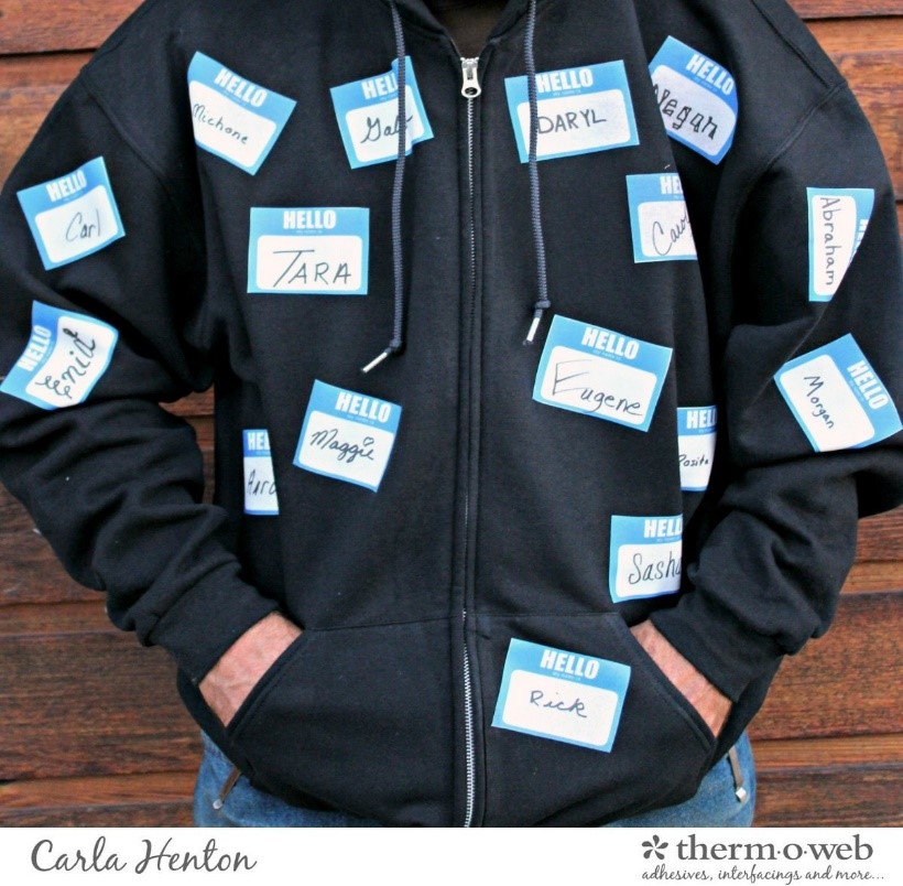 A person in a Halloween costume with many identities displayed in name tags