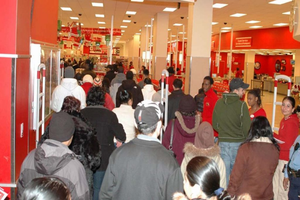 Shoppers enter a Target store location on a Black Friday in the early 2010s