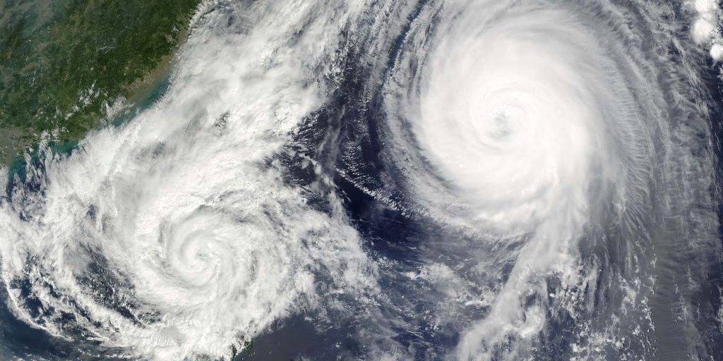 Two hurricanes spin in the open Atlantic or Pacific