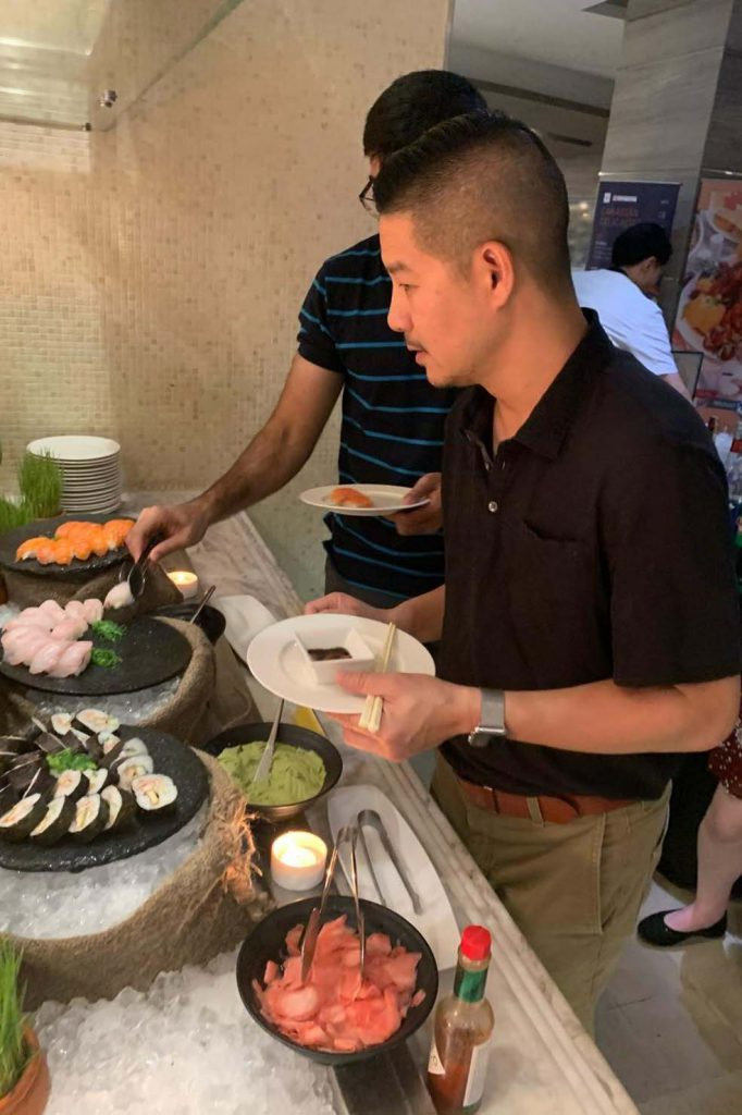 Tam Nguyen, president of Advance Beauty College and CSUF alumnus, enjoys a dinner in Vietnam.