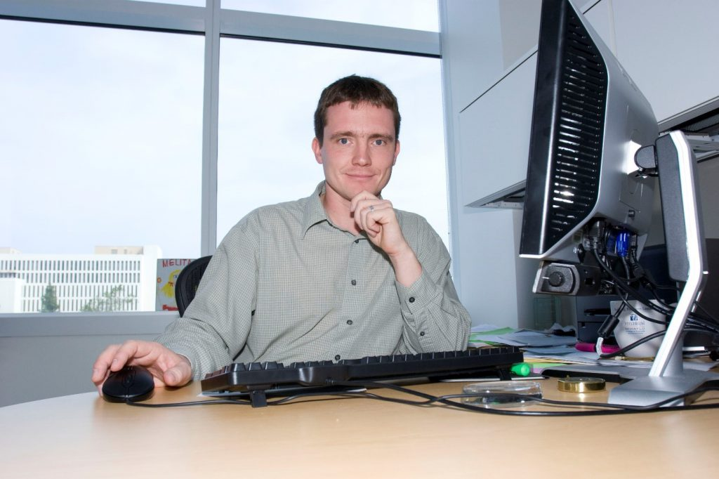 Pawel Kalczynski, Cal State Fullerton ISDS professor, at his desk at Steven G. Mihaylo Hall in this 2009 image.