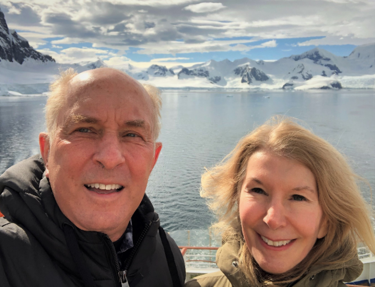CSUF finance professor Mark Stohs and his wife, Joanne, on a board at the coast of Antarctica.