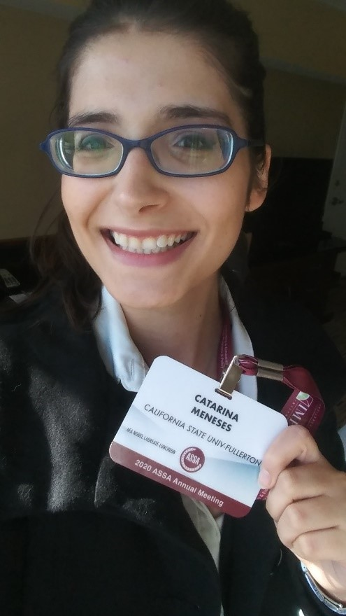Catarina Meneses holds her name tag at the American Economic Association conference in 2020.