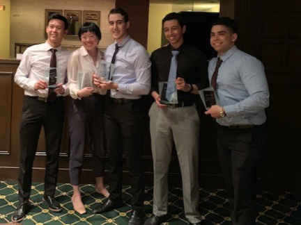 Five Cal State Fullerton students at the Titan Capital Management program at the Los Angeles local competition.