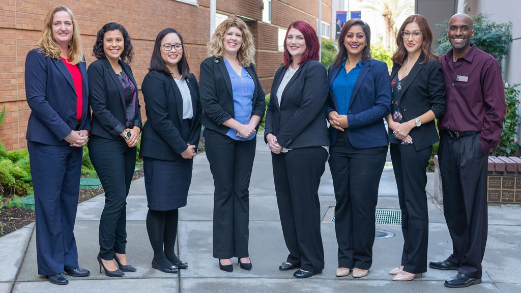 Members of Cal State Fullerton's Mihaylo Career Services staff pose for a group photo