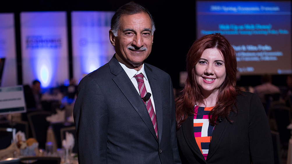 CSUF economists Anil Puri and Mira Farka at an economic forecast event.