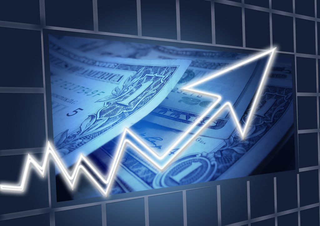 Photo showing dollar bills and a rising trend line