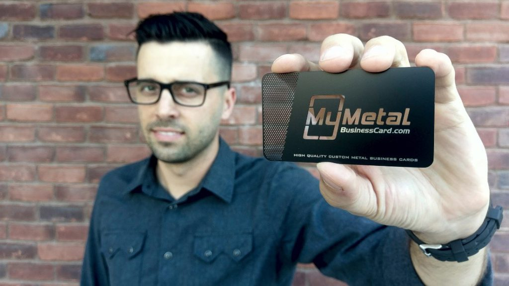 Craig Martyn holds up one of his company's metallic business cards