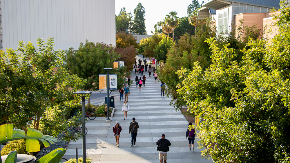 Students walk past water tower on CSUF campus