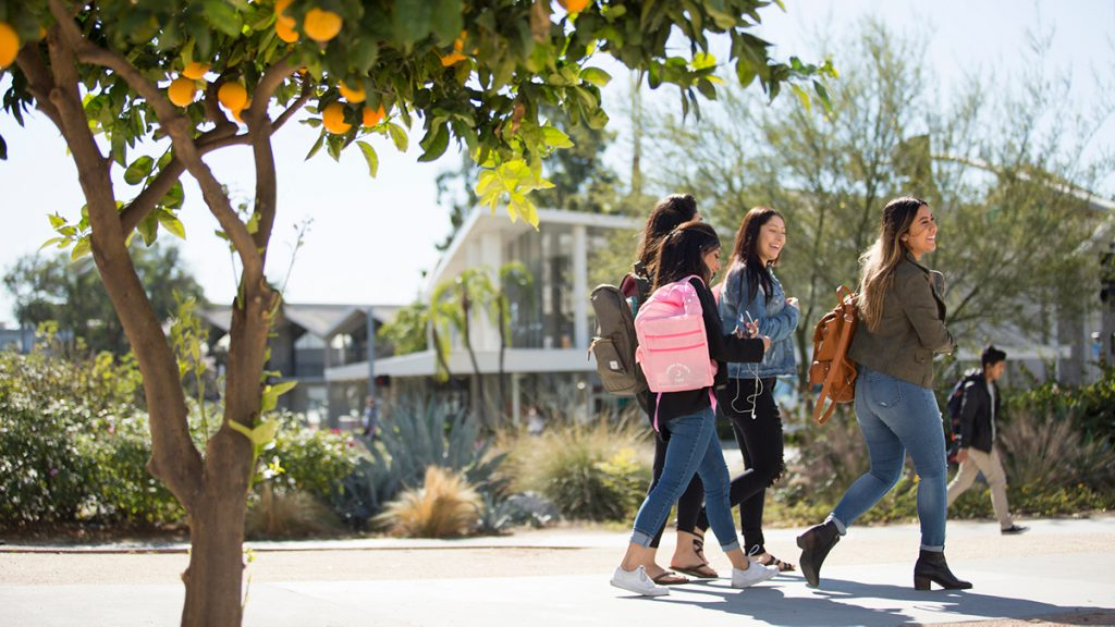 Students walk on campus at Cal State Fullerton