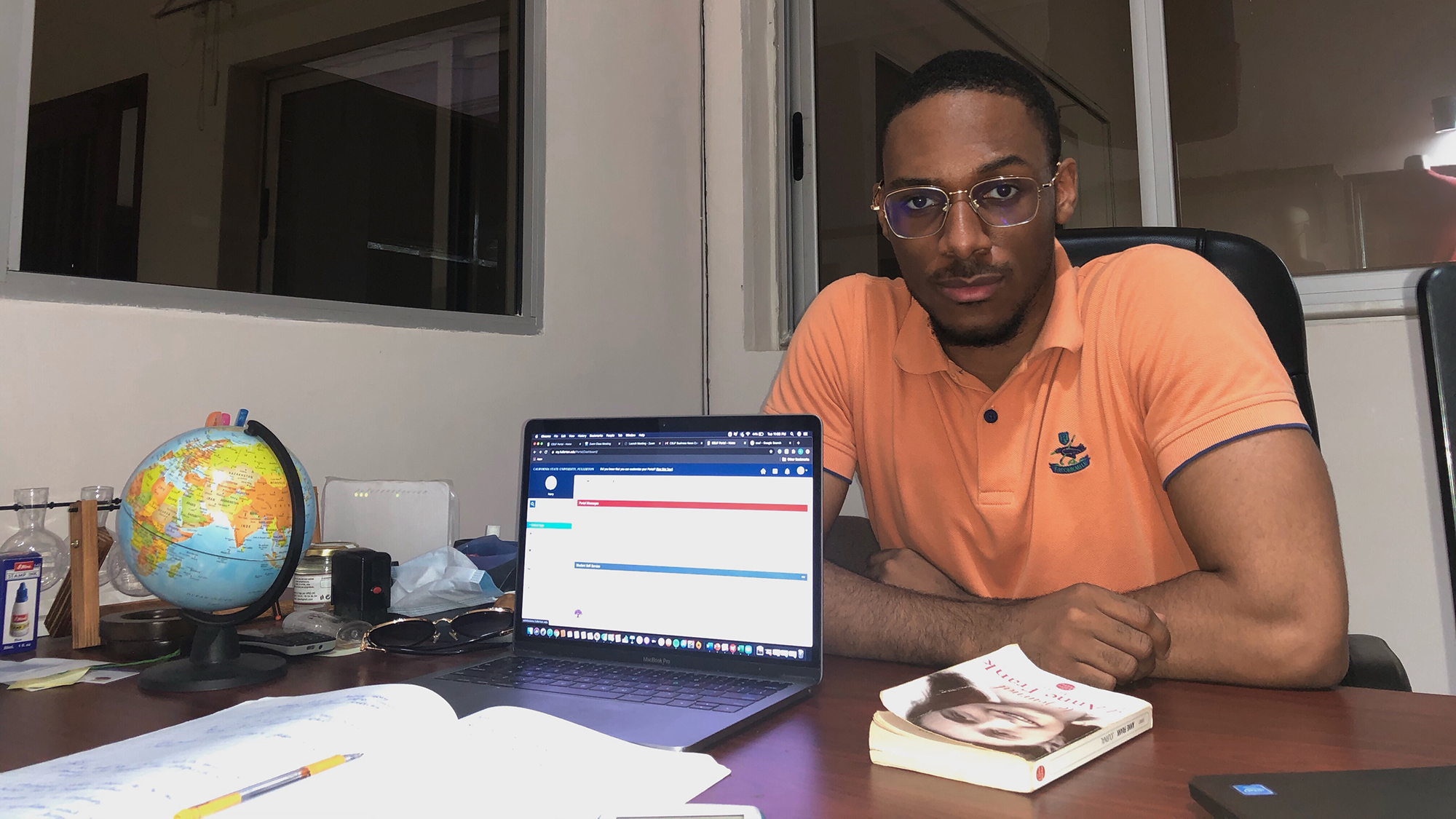 Student Harry Amouzou in his study area in Lomé, Togo