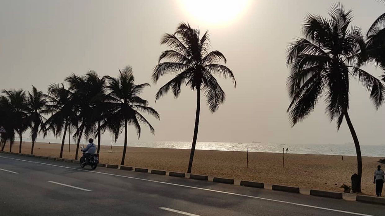 motorcyclist on road near beach iin the country of Togo