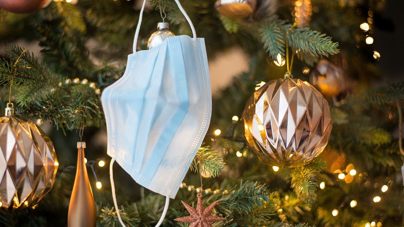 face mask hanging on a christmas tree