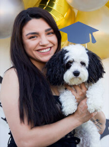 Genesis Osuna '20 and her support dog, Monito