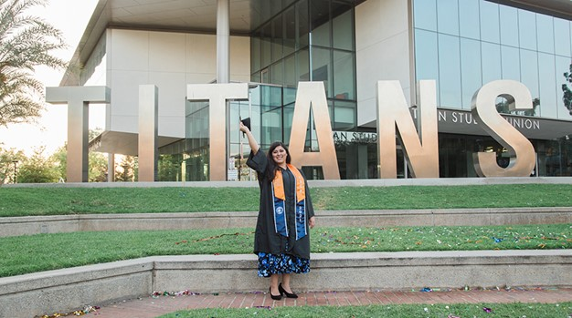 Judy Miranda poses outside of the Titan Student Union on the campus of Cal State Fullerton